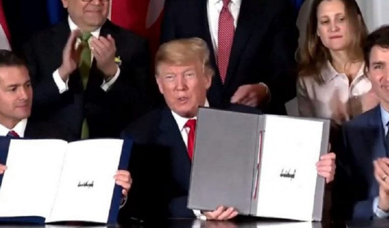 Trump Clueless During New Trade Deal, Caught Trying To Copy Other World Leaders In Live Signing