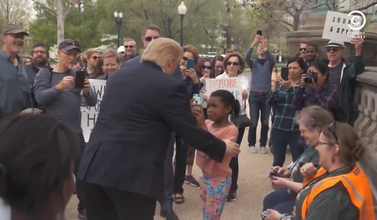 """Social Media Hails Little Girl A """"Hero"""" After She Stands Up To Trump Lookalike"""