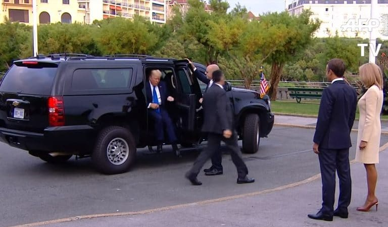 Image Of Trump Stepping Out Of A Car In France Appears To Show POTUS Wearing High-Heeled Shoes